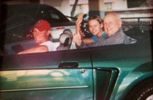 My brother, Grandpa, and me in our convertible! Grandma took the picture :)